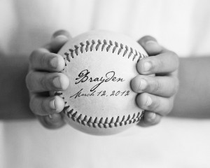 hands holding baseball