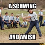 a schwing and amish with amish man swinging a bat