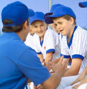 baseball coach talking to players