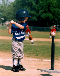 boy playing tball