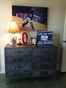 locker-dresser-with-baseball-jar-lamp-and-baseball-painting-above