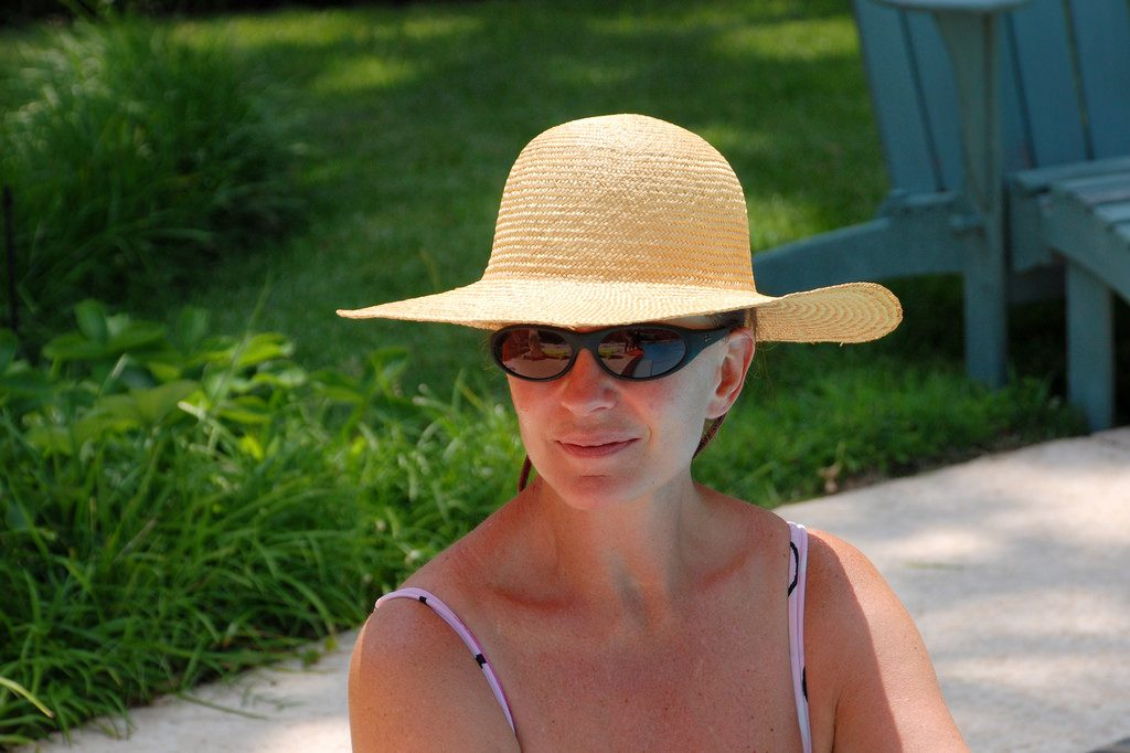 woman in large floppy hat