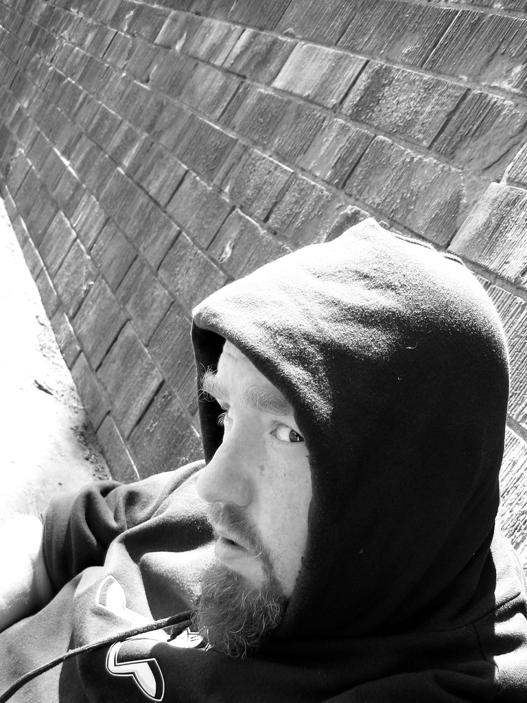 man in hoodie with side glance