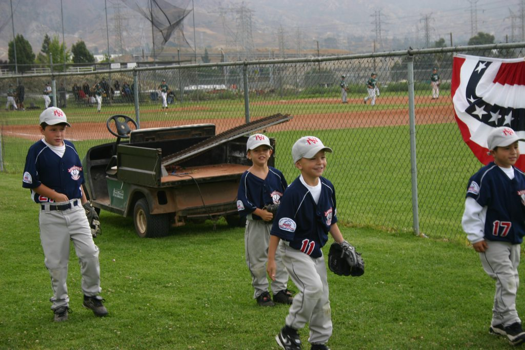 young baseball players having fun