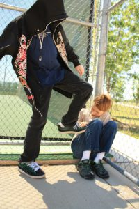 bully kicking a kid