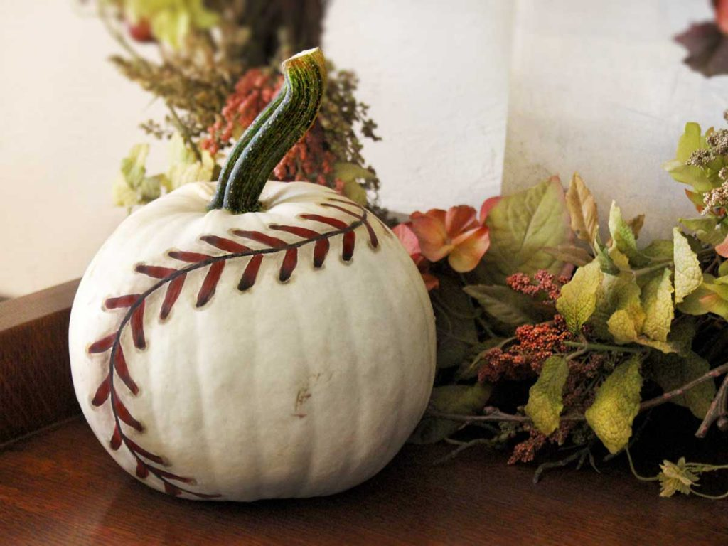 white painted baseball pumpkin