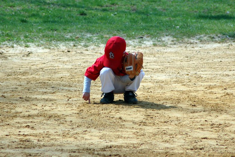 baseball player playing with dirt
