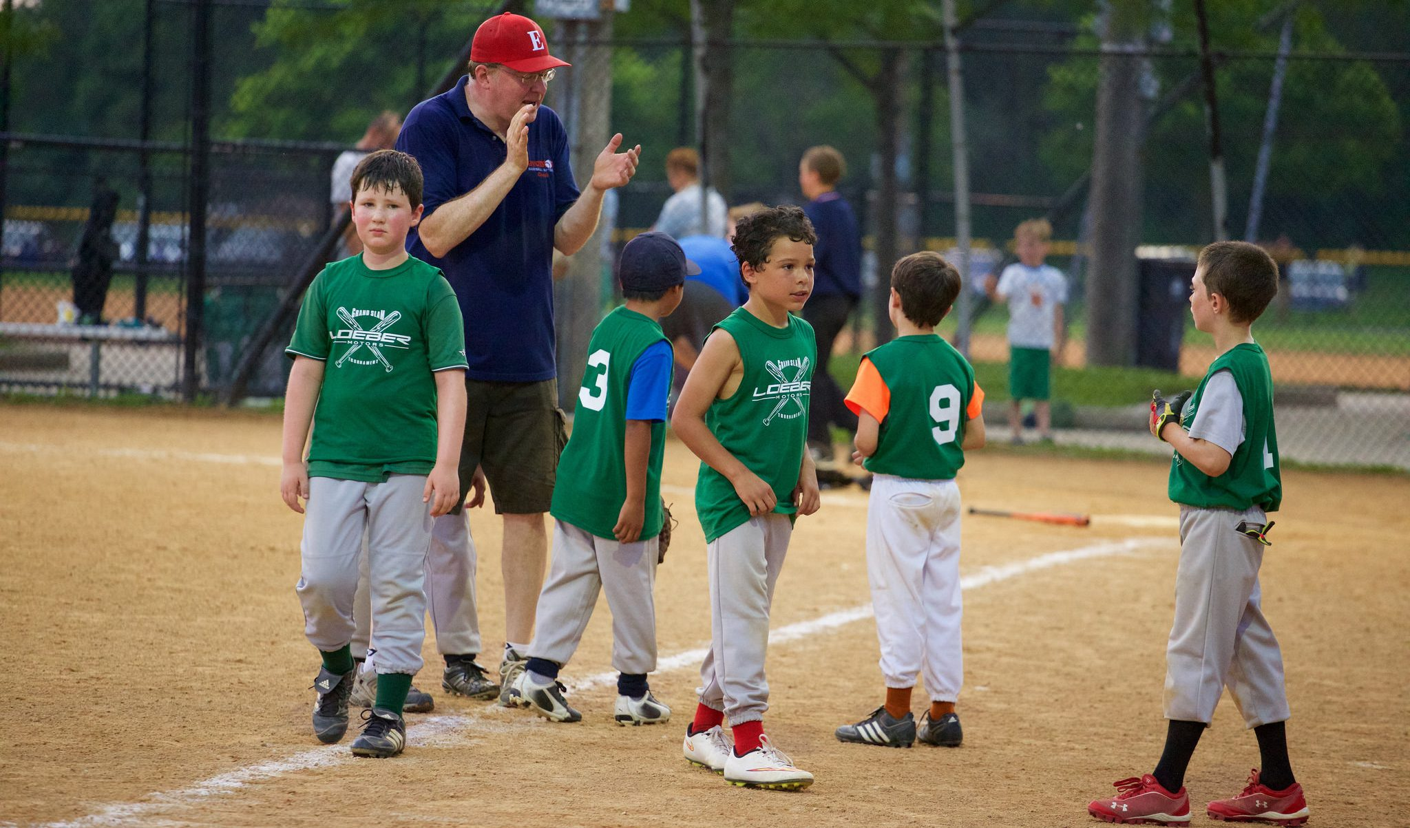 coach encouraging baseball team