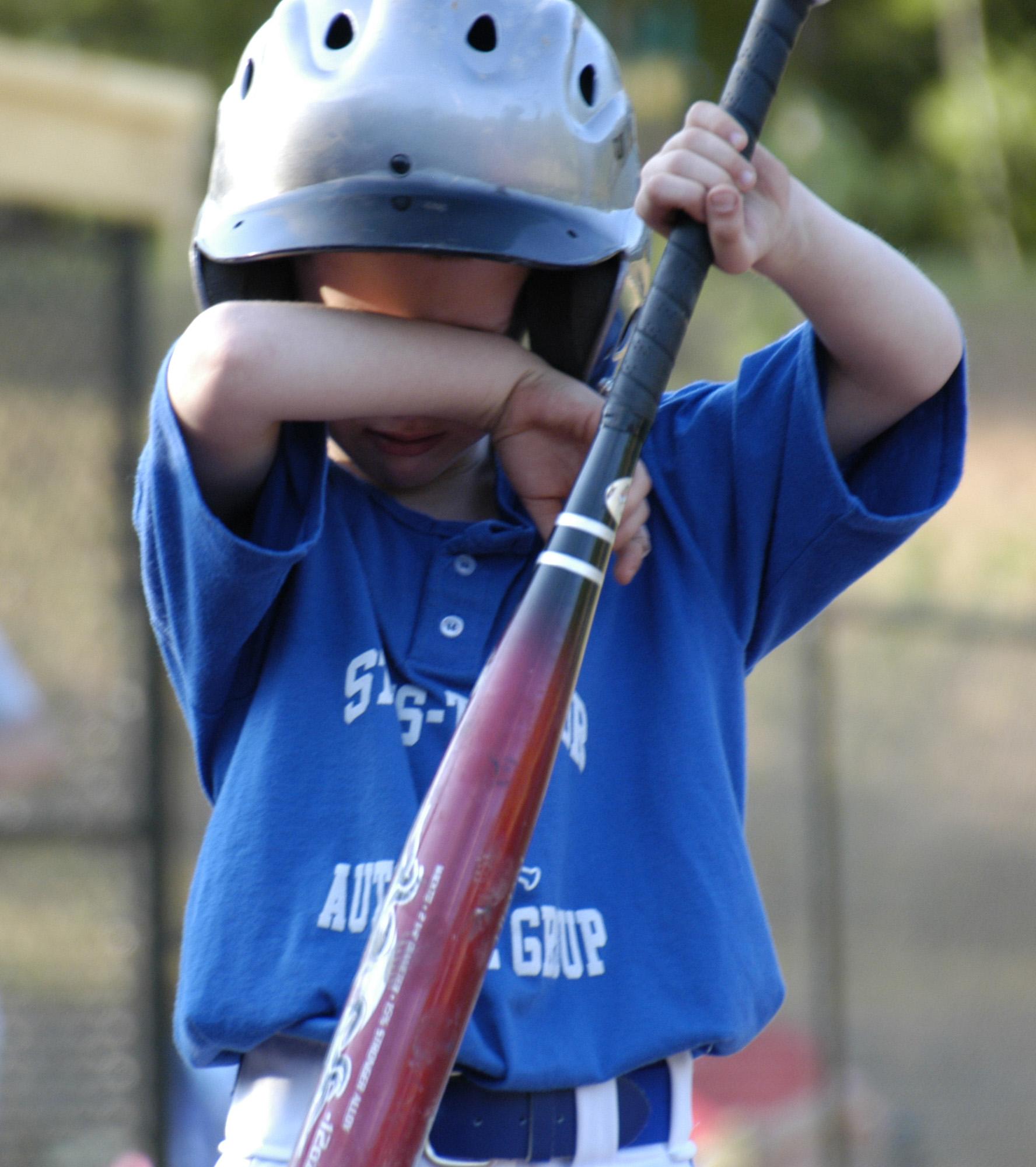 sad baseball kid