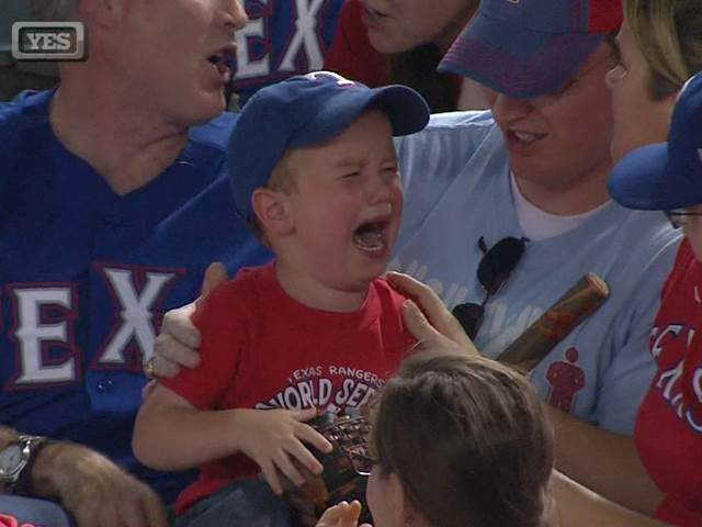boy crying at baseball game