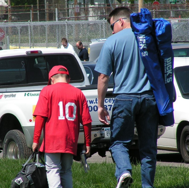 father and son after baseball game
