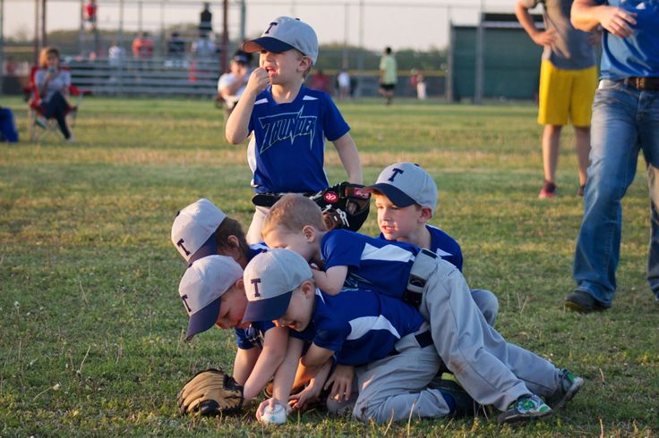 tee ball players converging on ball