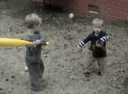 toddlers playing baseball