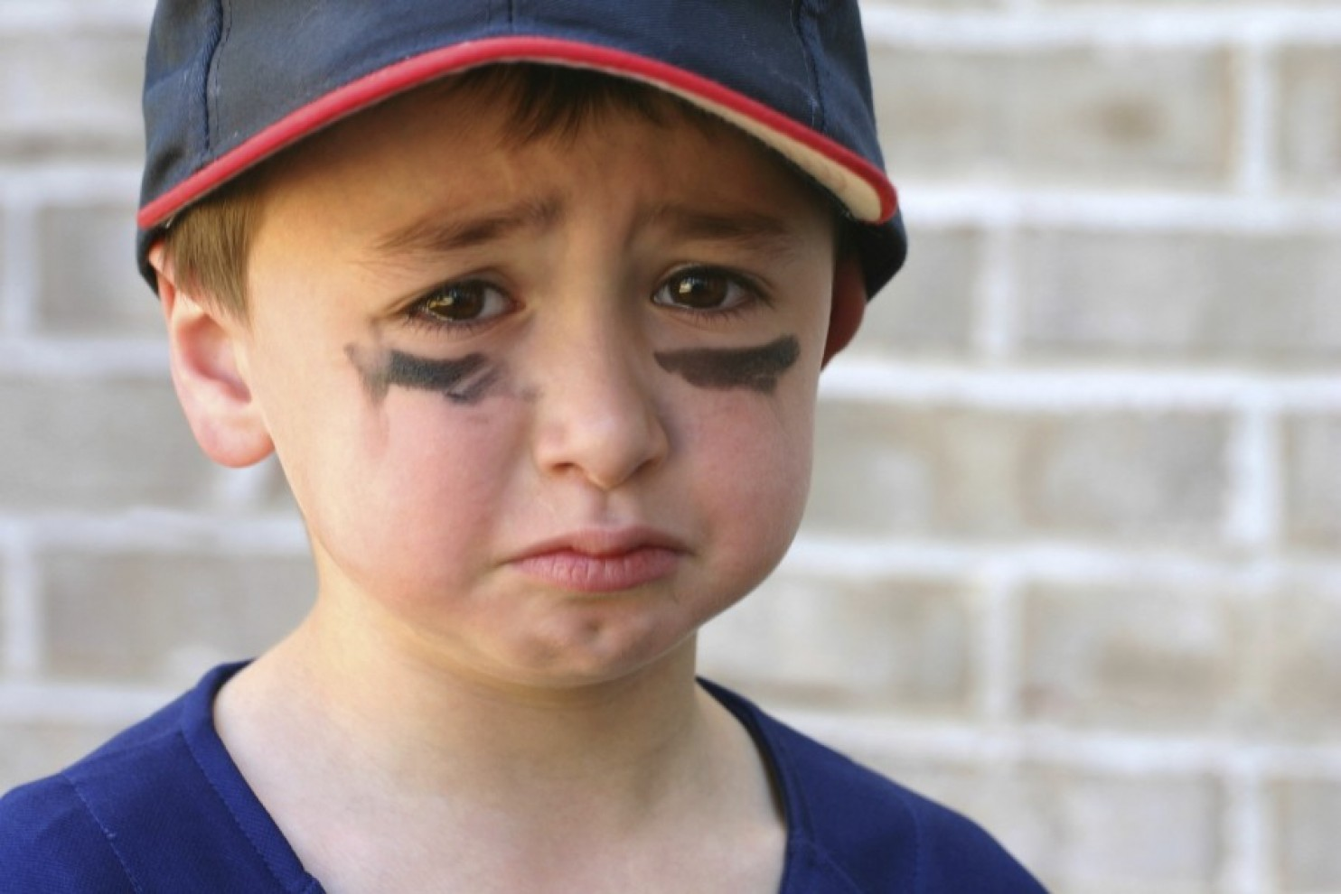 sad baseball boy