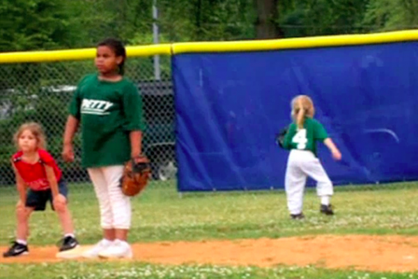 girl in outfield runs the wrong way