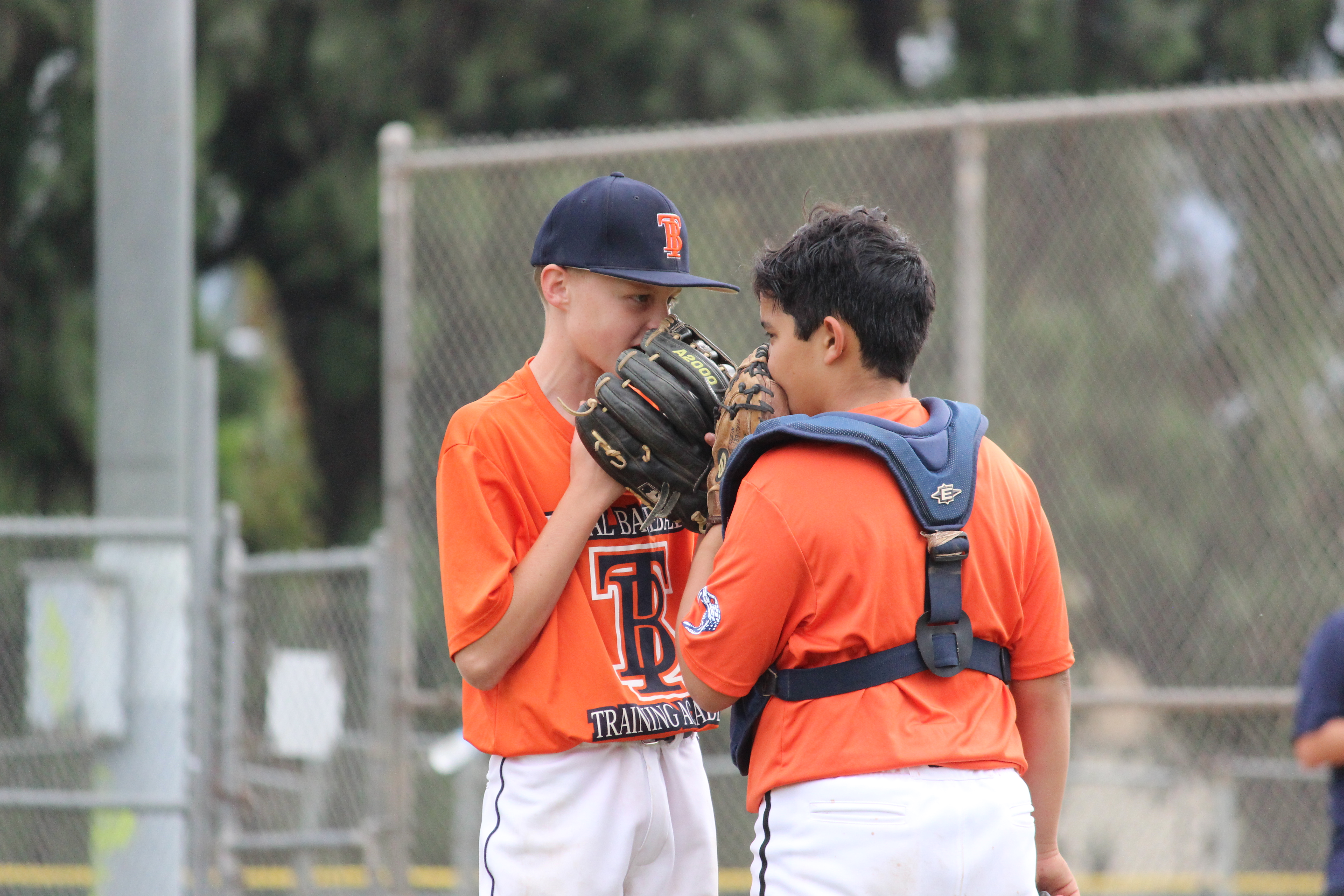 pitcher catcher meeting on the mound
