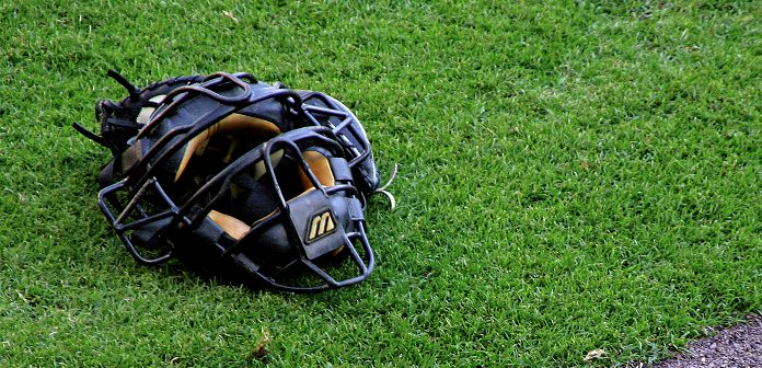 baseball glove on grass