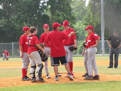 coach talking to baseball players