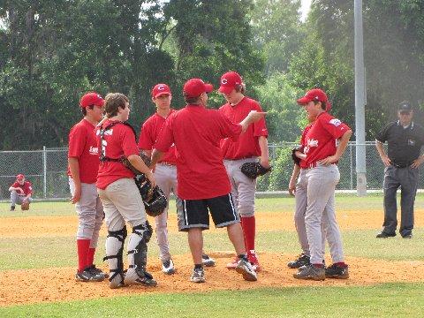 coach talking to baseball players