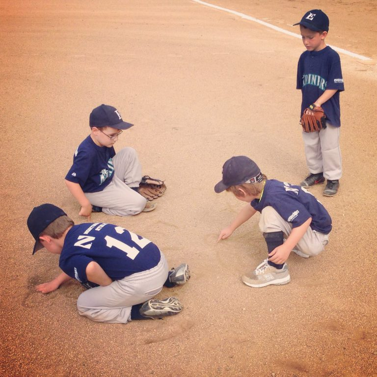 baseball kids playing in the dirt