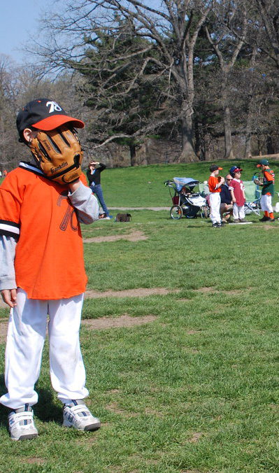 baseball boy sniffing his glove