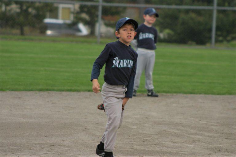 baseball kid with glove between legs