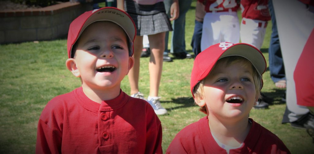 2 baseball kids in red uniforms
