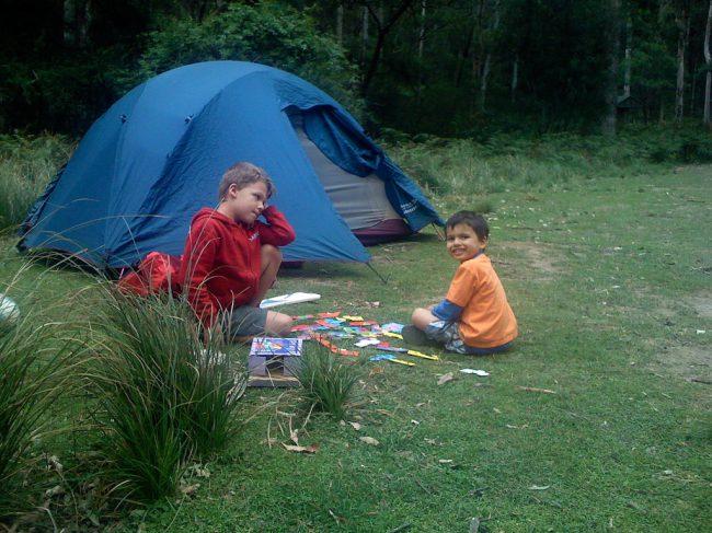 little boys near a tent