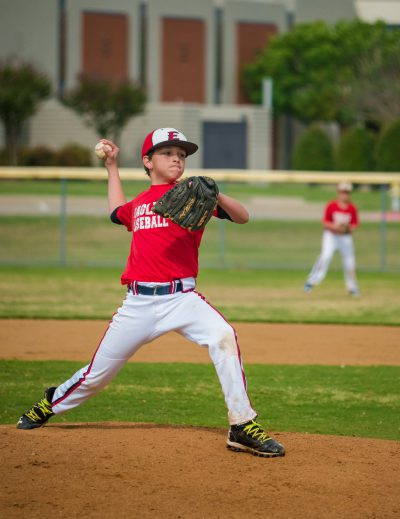 youth pitcher in red jersey