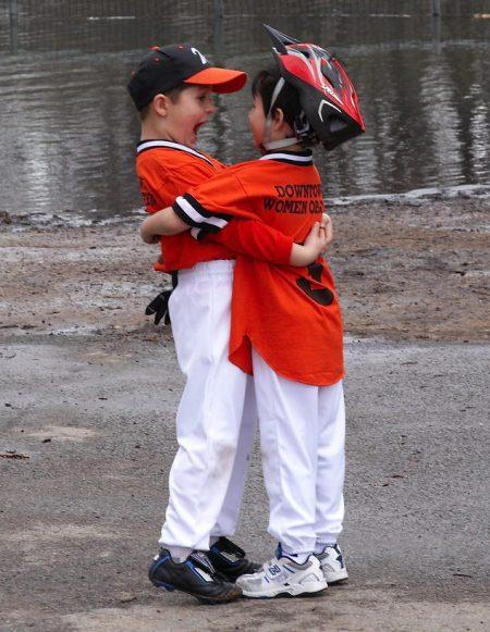 cute baseball kids hugging