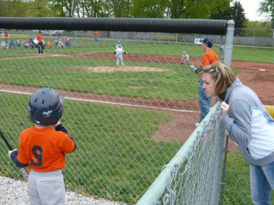 mom talking to baseball player