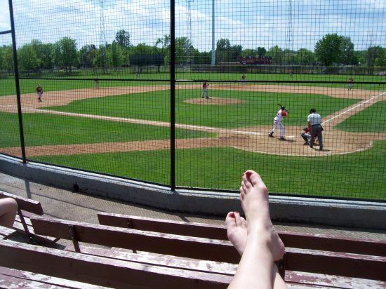 baseball fan with feet up
