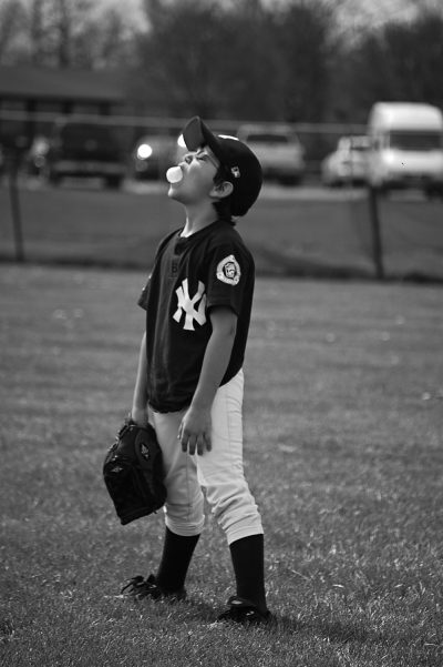 baseball kid blowing a bubble