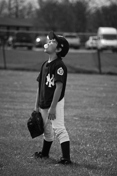 baseball kid blowing a bubble