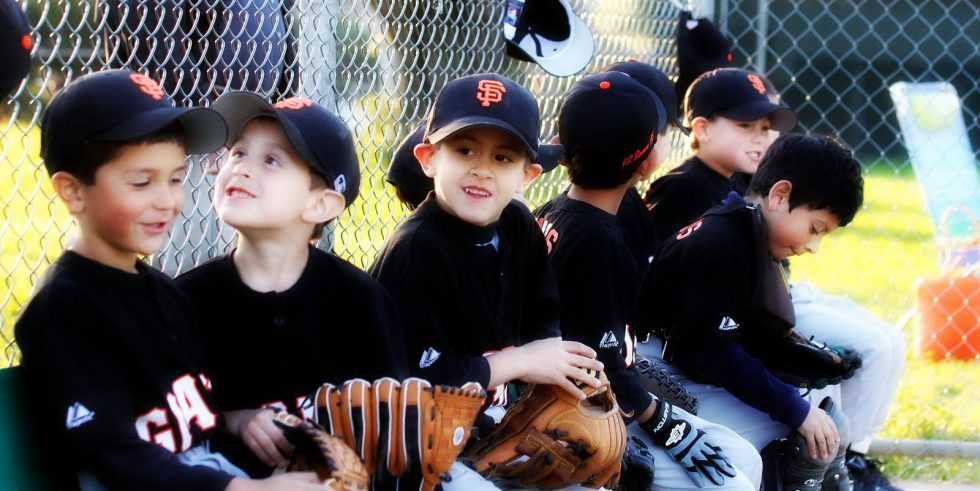little baseball players in the dugout