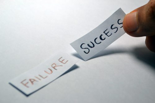 failure and success written on paper